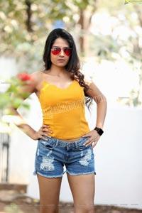 Simar Singh in Yellow Spaghetti Strap Crop Top