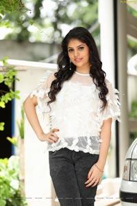 Viswa Sri Bandhavi in White Net Top and Black Jeans