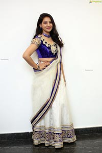 Anchor Vijayalakshmi in White Net Ornate Lehenga Choli