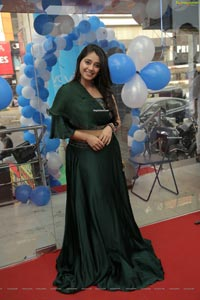Chandni Bhagwanani in Bottle Green Dress
