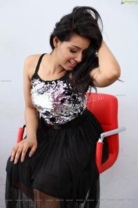 Neha Goswami in Black Sequin Embellished Skater Dress