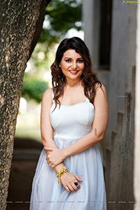 Actress Nisha Singh Rajput in White Mini Dress