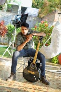 Bhushan Poses Holding Guitar