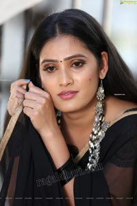 Anusha Parada in Black Saree With Gold Border