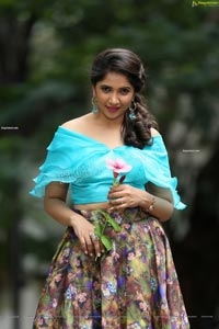Indu in Sky Blue Frill Crop Top and Floral Lehenga