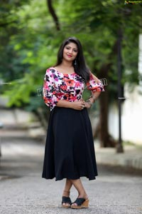 Shabeena Shaik in Blue Floral Top and Black Skirt