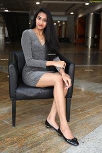 Laya Jupally in Gray Knit Bodycon Dress