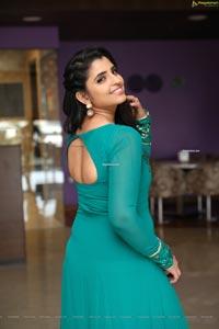 Shyamala in Teal Blue Slit Dress