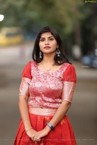 Kirthana Shiny in Red Ornate Lehenga