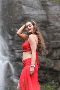 Payal Rajput Posing in a Red Flowing Dress