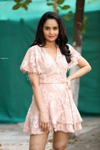 Usha Kurapati in Champagne Lace Mini Dress