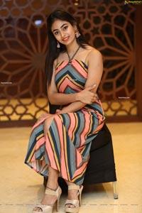 Honey Chowdary in Multi Striped Slender Halter Neck Dress