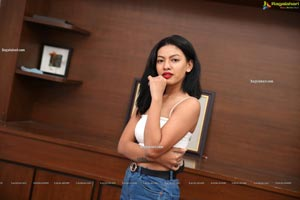 Kavita Mahatho in White Spaghetti Strap Crop Top and Jeans