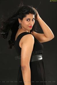 Akhila Ram in Black Sleeveless Tank High-Low-Hem Dress