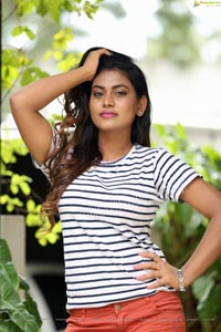 Priyanka Augustin in White Striped Top and Shorts