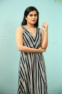 Tara Chowdary in Black and White Striped Dress