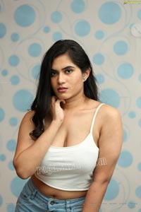 Tara Chowdary in White Spaghetti Strap Crop Top and Jeans