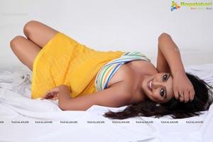 Tashu Kaushik in Shoulderless Yellow Dress