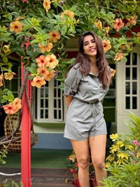 Nabha Natesh Posing With Allamanda Flowers
