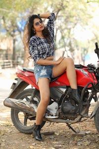 Simar Singh Posing on Motorcycle
