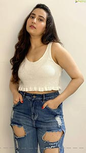 Manjusha in White Smocked Crop Top and Ripped Jeans