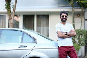 Kiran Talasila Poses in Style With a Car