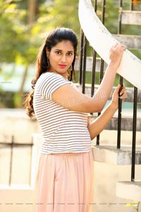 Akhila Ram in Pastel Pink Skirt and Stripes Top