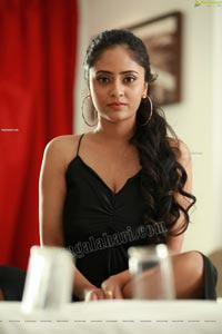Sanya Thakur in Black Spaghetti Strap Satin Dress