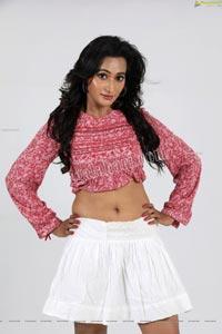 Nisheetha in Pink Crop Top and White Mini Skirt