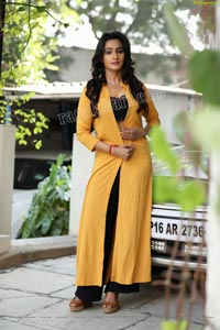 Nisheetha in Yellow Long Shrug and Black Pant
