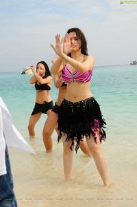 Tamanna Hot Rebel Beach Song Photos