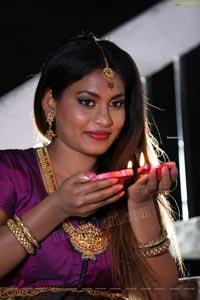 Priya Augustin Holding Diya
