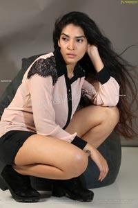 Supraja Narayan in Pastel Pink Shirt and Black Shorts