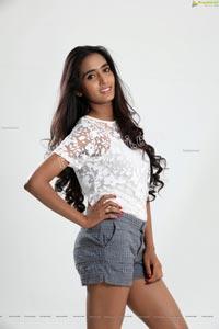 Bharathi Parli in White Top and Denim Shorts