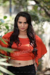 Preyasi Jiggar in Orange Crop Top and Black Torn Jeans