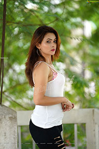 Pranita Waghchoure in Black Ripped Pant and White Tank Top